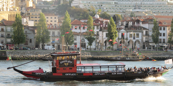 A traditional port barge sailing down the Douro River
